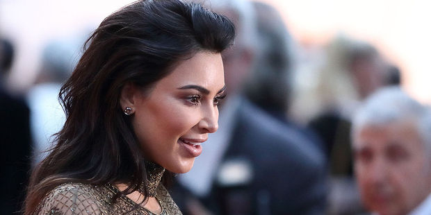 Kim Kardashian turned mobile game magnate has landed the cover of Forbes magazine's July 26 issue. Photo / Getty Images