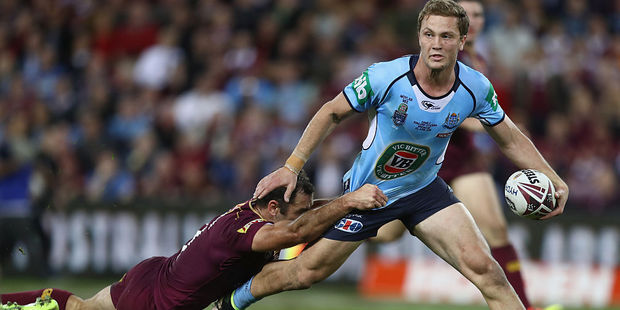 Matt Moylan of the Blues is tackled by Cameron Smith of Queensland. Photo / Getty