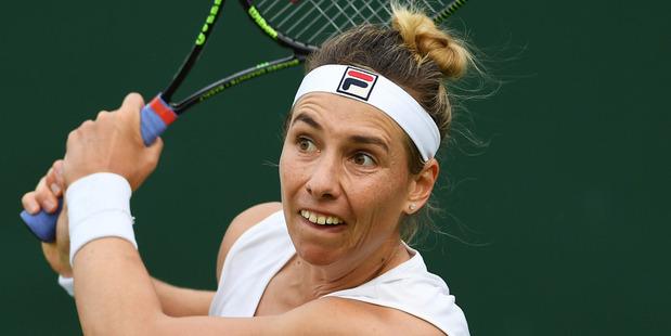 Marina Erakovic plays a backhand against Irina Falconi at Wimbledon. Photo / Getty Images