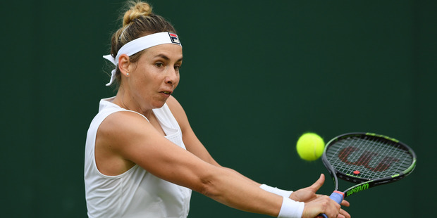 Marina Erakovic plays a backhand during her first round match at Wimbledon. Photo / Getty Images