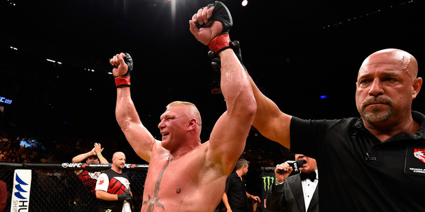 Brock Lesnar reacts to his victory over Mark Hunt in their heavyweight bout during the UFC 200 event. Photo / Getty