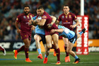 Greg Inglis is tackled during game three of the State Of Origin series. Photo / Getty
