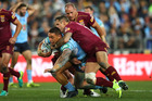 Tyson Frizell of the Blues is tackled during game three of the State Of Origin series. Photo / Getty Images