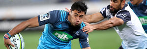 Melani Nanai of the Blues is tackled by Reece Robinson of the Waratahs. Photo / Getty