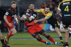 Nemani Nadolo of the Crusaders is tackled by James Marshall of the Hurricanes. Photo / Getty