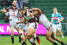 Martin Taupau of the Sea Eagles is tackled by the Warriors defence. Photo / Getty