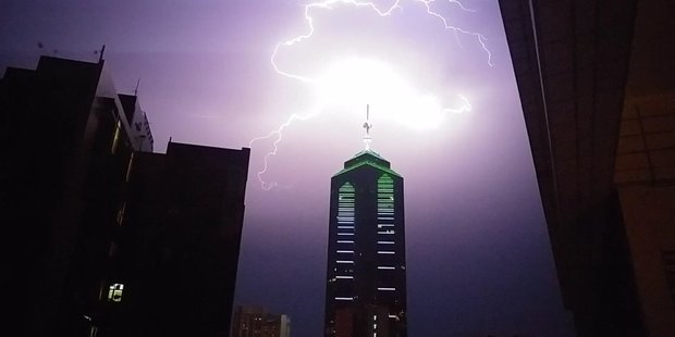 Hong Kong was hit by a record  over 10,000 lightning strikes  at the weekend. Photo / @Copeau1, Twitter