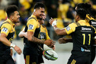Vaea Fifita of the Hurricanes is congratulated on his try by teammates Ardie Savea, Reggie Goodes, Julian Savea and Michael Fatialofa. Photo / Getty Images.