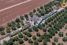 This aerial handout photo shows what is left of two commuters trains after their head-on collision in the southern region of Puglia. Photo / AP