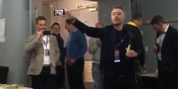 The Hurricanes celebrated making the Super Rugby playoffs with an impromptu sing along with Irish singer-songwriter Ronan Keating. Photo / Twitter.