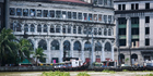 The Pasig River flowing past old run down historic buildings in the centre of Manila. Photo / Getty