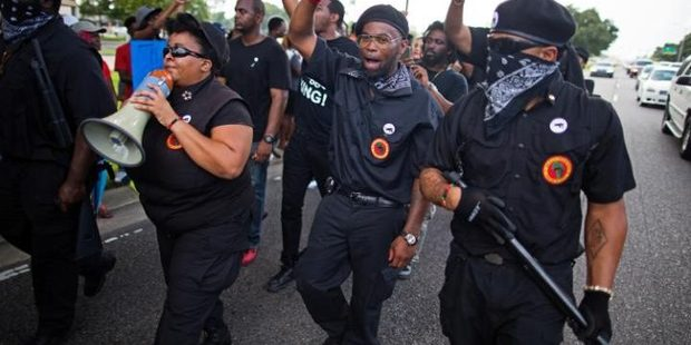 Members of the New Black Panther Party march in front of the Baton Rouge police department at the weekend. Photo / AP