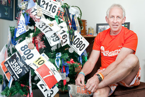 Ross Steele has decorated his Bellevue home with running bibs medals and photos. Photo/Andrew Warner