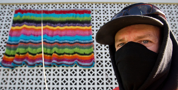 Greerton Guerilla Khan Maguire with one of the pieces of yarn art. Photo / Alan Gibson