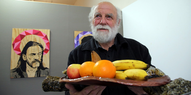 ROCK DREAMS: Ceramicist Peter Lange with one of his rock-inspired platters. PHOTO/STUART MUNRO