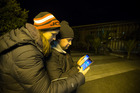 Pokemon Go gamers Jordan Jamieson (left) and Greg Ruaporo spent some time last night looking for Pokemon at Birkenhead Library, along with many others. Photo / Nick Reed