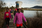 Rotorua's Faustinah Ndlovu managed to walk 21km around Lake Rotorua with a 20l bucket filled with water balanced on her head as part of a fundraising initiative.