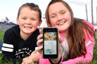 POKEMON IN THE BAY: Campbell Davies 8, and Charlotte Davies, 12, have caught the Pokemon GO app fever, sweeping Tauranga. PHOTO/GEORGE NOVAK