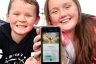 Launched last week, the Pokemon GO app is an augmented reality game, which combines an image of a Pokemon cartoon character, with the user's real world view. Campbell Davies 8, and Charlotte Davies, 12, have caught the Pokemon GO app fever.