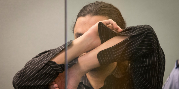 Michael Stevens covered his face throughout today's sentencing. Photo / Greg Bowker