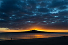 Sunrise over Rangitoto at Narrow Neck Beach in Devonport on Auckland's  North Shore. Photo / Brett Phibbs