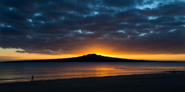 Sunrise over Rangitoto at Narrow Neck Beach in Devonport on Auckland's  North Shore. Photo / Brett Phibbs