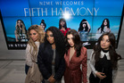 Four of the five of the pop group Fifth Harmony pose for a quick photograph, before they get interviewed in the ZM studio at the NZME building, Auckland City. Picture / Brett Phibbs