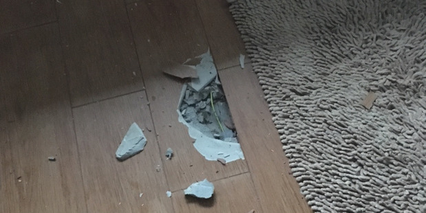 Damage to the bathroom floor of a house in Clevedon after it was struck by lightning. Photo / Supplied