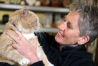 BUSY BOY: Wilson the cat with his owner Emma Camden. PHOTO/STUART MUNRO