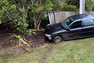 A car lost control in Okoia on Thursday night, crashing into a pole and fence. Photo/Stuart Munro