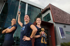 CELEBRATION: Rotorua constables, from left to right, Kim Welsh, Rowan McKinlay and Katie Bell after running the torch through the Redwoods to the station for the ceremony. PHOTO/BEN FRASER