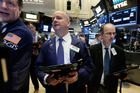 Trader Patrick Casey, centre, works on the floor of the New York Stock Exchange. File photo / AP