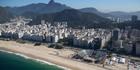 The Olympic beach volleyball venue under construction on Copacabana Beach. Photo / AP