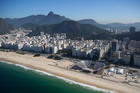 The Olympic beach volleyball venue under construction on Copacabana Beach. Photo / AP