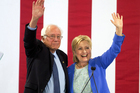 Democratic presidential candidate Hillary Clinton and Senator Bernie Sanders wave to supporters with during a rally where Sanders endorsed her for president. Photo / AP