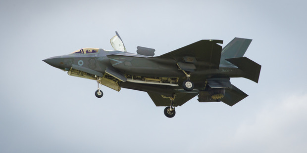 The F-35 Lightning II hovers in front of crowds during its first solo appearance at the Farnborough Air Show. Photo / AP