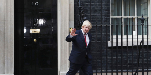 Boris Johnson leaves 10 Downing Street after being appointed Foreign Secretary. Photo / AP