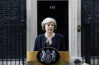 New British Prime Minister Theresa May speaks to the media outside her official residence, 10 Downing Street in London. Photo / AP