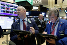 Trader James Riley, left, and Richard Newman, right, work on the floor of the New York Stock Exchange. File photo / AP