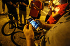 The Pokemon Go game prompted police to remind players to be mindful of dangers in the real world. Picture / AP