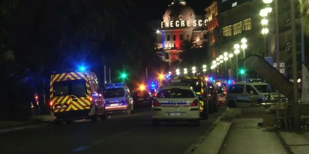 Ambulances and police cars rushed to the scene after a truck drove on to the footpath and ploughed through a crowd of revellers.