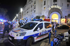 A police car is parked near the scene where a truck drove into a crowd of revellers who'd gathered to watch the Bastille Day fireworks in the French resort city of Nice.    Photo / AP