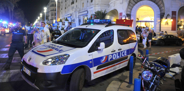 Loading A police car is parked near the scene of the attack. Photo / AP