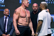 Brock Lesnar, left, looks at Mark Hunt during the UFC 200 weigh-ins in Las Vegas. Photo / AP.