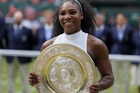 Serena Williams of the U.S holds up her trophy after beating Angelique Kerber of Germany in the women's singles final on day thirteen of Wimbledon. Photo/ AP.