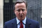 David Cameron is handing over the No 10 keys to Theresa May. Photo / AP