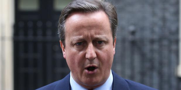 Loading David Cameron is handing over the No 10 keys to Theresa May. Photo / AP
