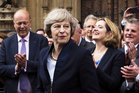 Britain's Theresa May is applauded by Conservative Party members of parliament outside the Houses of Parliament in London. Photo / AP