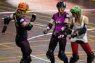 Skaters dance during a time out in the 2014 Slam Rock.