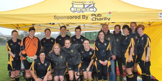 The Dannevirke women's football team, the Valkyries, prepare to battle the rain,  the cold and their opponents at the Dannevirke showgrounds on Sunday afternoon. Photo / Christine McKay